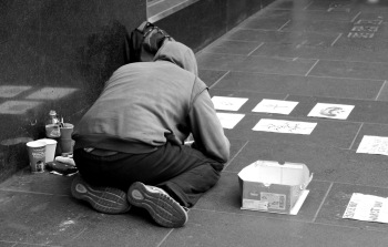 I saw this young homeless guy over a period of years. He went from making copies of drawings to being quite a skilled artist and earning enough to pay to have some of his cards printed (to sell on the streets).